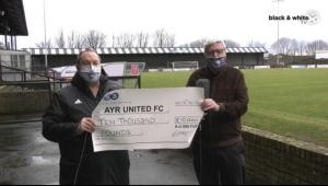 Jamie & Robert present cheque to Club.